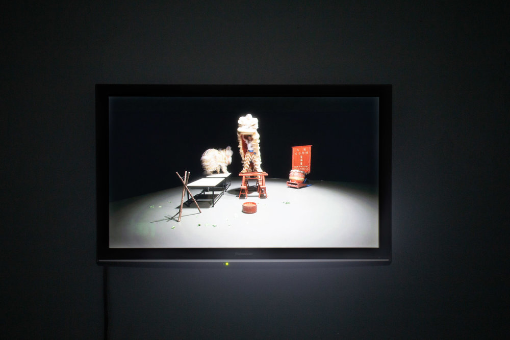 Samson Young,  Muted Situation 2 (Muted Lion Dance) , 2014, instructions for a performance, single channel video with sound, 7 min 21 sec.  Photo: Kilian Bannwart