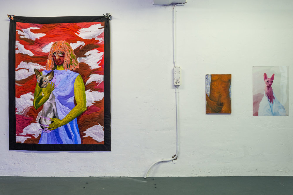 Left: Xénia Lucie Laffely,  The sky is red like my face and my anger,  2018,   embroidered quilt, 180 x 160 cm Middle: Dieter Hall,  Mach es wie die Sonnenuhr, zähl die heiteren Stunden nur,  2004, oil on canvas, 56 x 35.5 cm Right: Xénia Lucie Laffely,  My cat is a witch,  2018, acrylic print, 70 x 50 cm  Photo: Kilian Bannwart