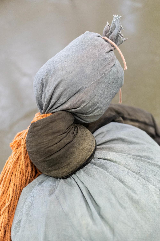 Megan Rooney,  Kaput Kaput  (detail), 2019, fabric, rope, paint, mops, teddy bear, produce sacks, car wheel, brushes, dimensions variable Photo: Kilian Bannwart