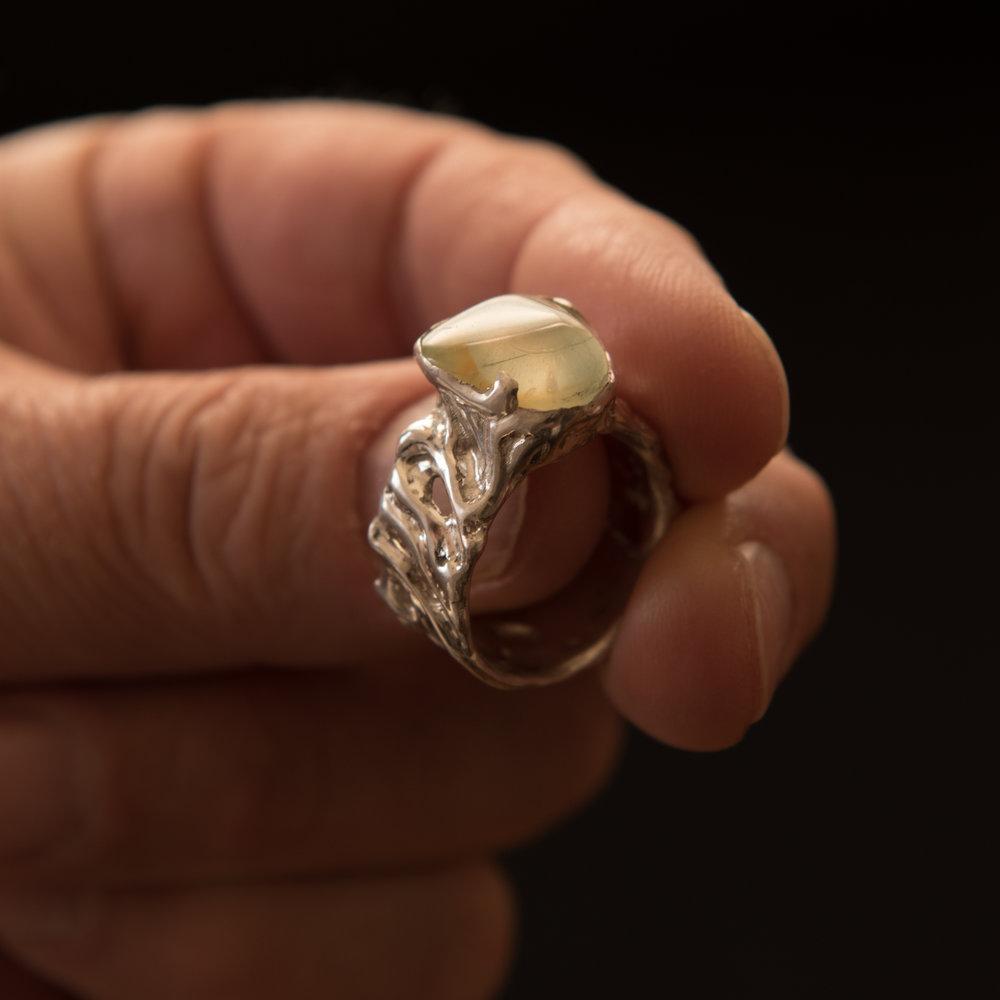 Stone in Decorative Silver Band, $300