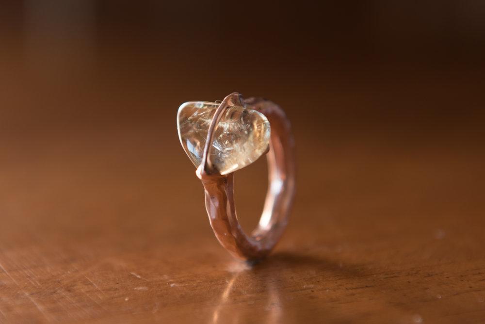 Glassy Stone in Copper, $150
