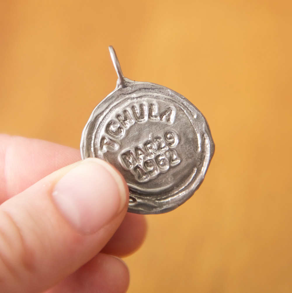 Silver Stamp Pendant, $40