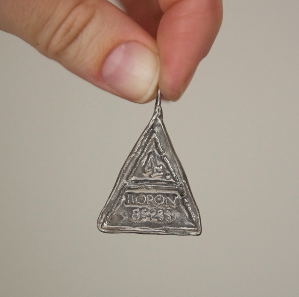 Triangle Silver Stamp Pendant, $40