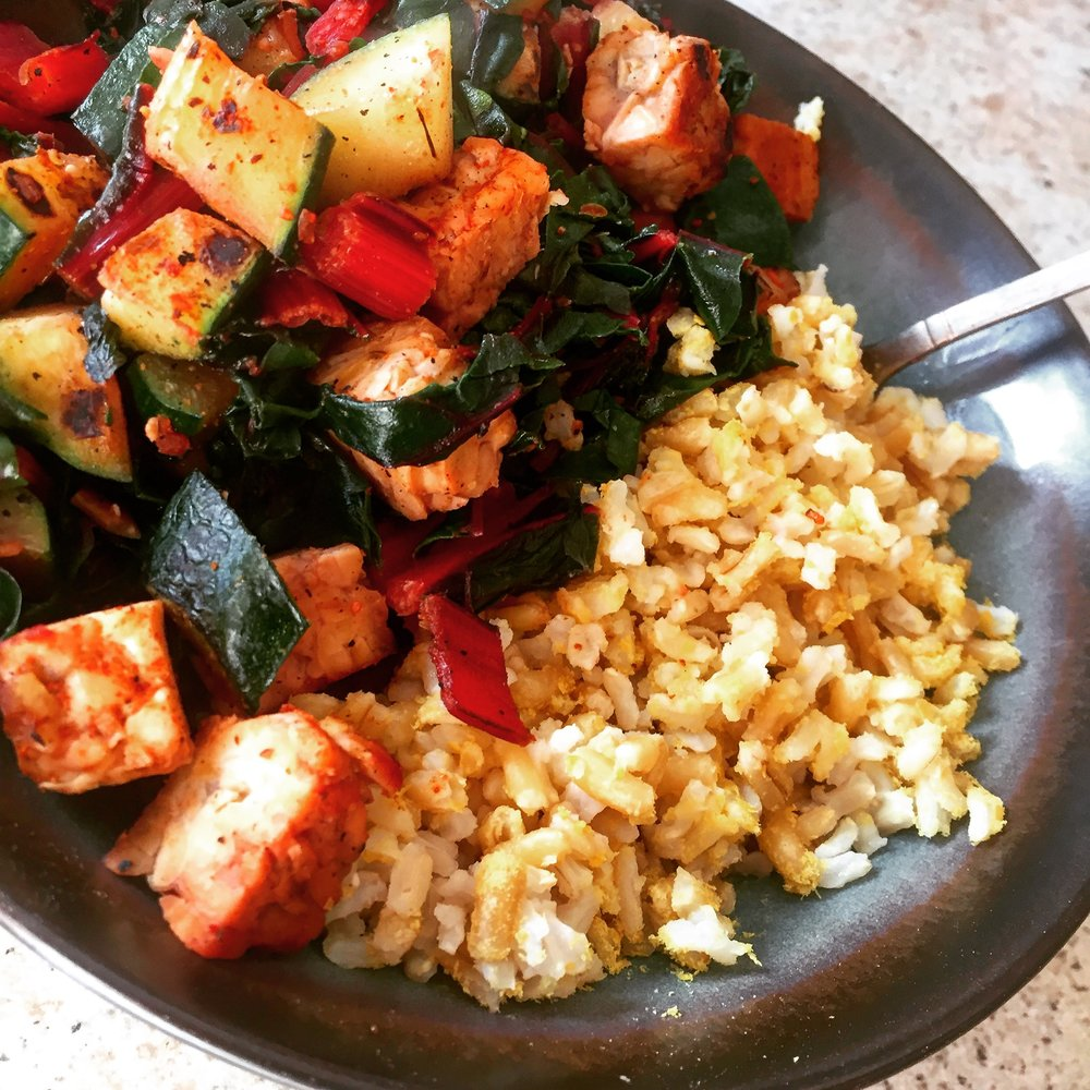 "Veggies and seared tempeh with nutritional yeast ""cheesy"" rice."