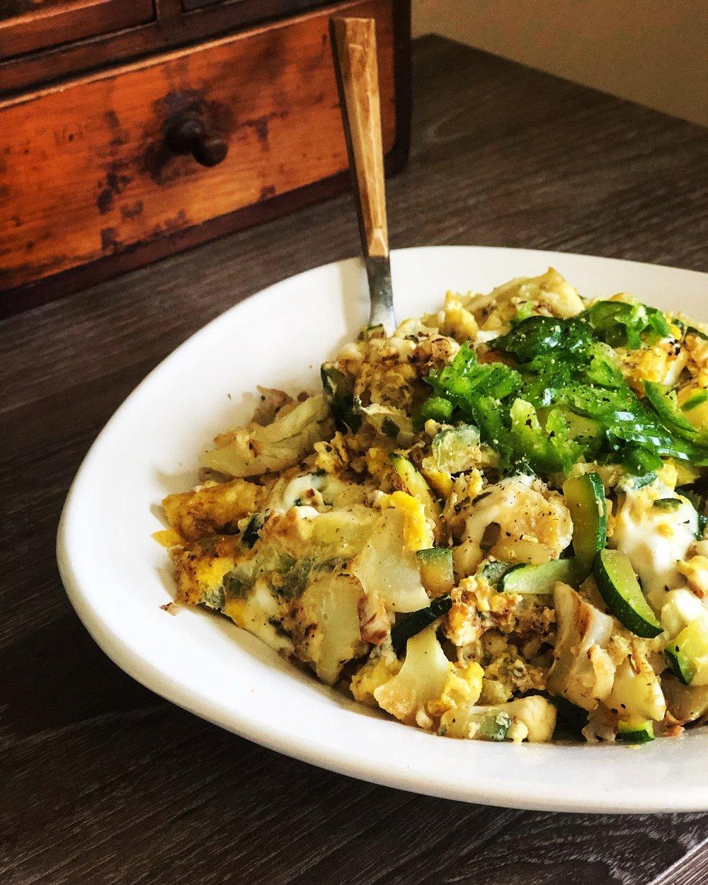 Cauliflower has with zucchini, eggs, mozzarella, sage, and jalapeño.