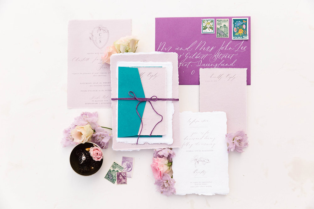 Stationery by  Little Duck Calligraphy . Photography by  Poppy & Sage Photography .