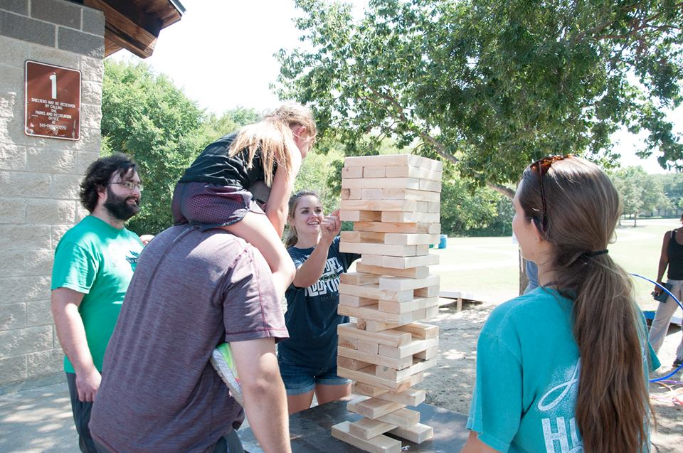 Father and daughter playing Jenga at Backyard Bash