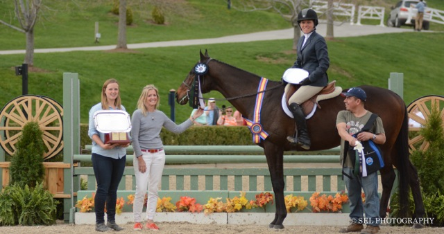 Caitlin Malloy Brennan awarding the 2015 Champion ribbon to Hennepin Shine and Keirsten Johnsen