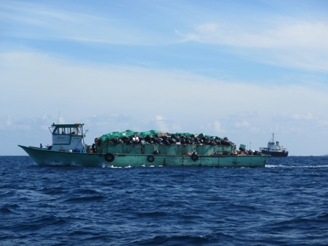 "A barge bringing waste to be burned to Thilafushi, nicknamed ""Trash Island."""