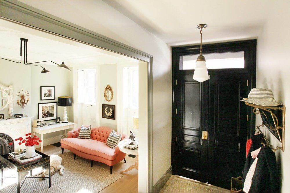 A brass train rack, like the one used above as an entry catchall, is a nice alternative to boring hooks. I spy one of my favorite Urban Electric  fixtures !