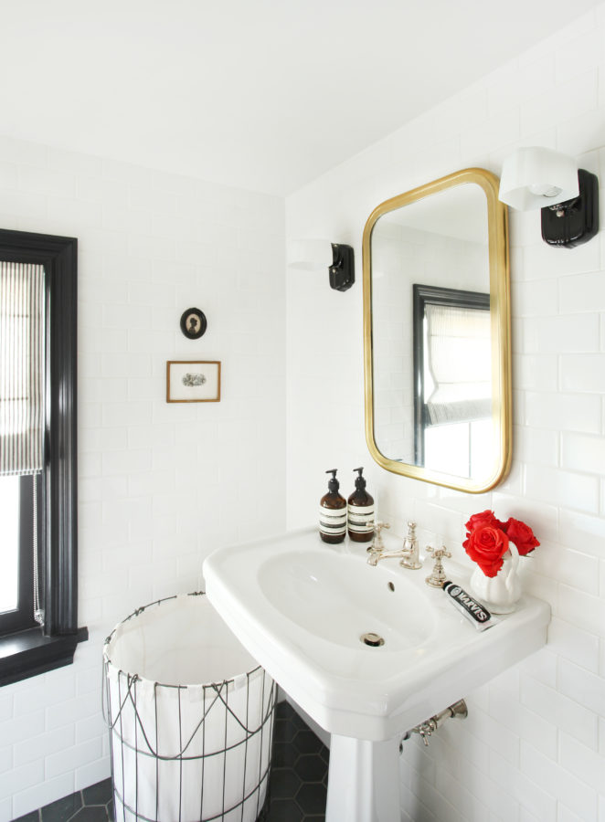If you want a bathroom you don't have to remodel in 10 years, white subway tile will never go out of style. Black and brass accents make this monochromatic powder feel so clean and fresh.