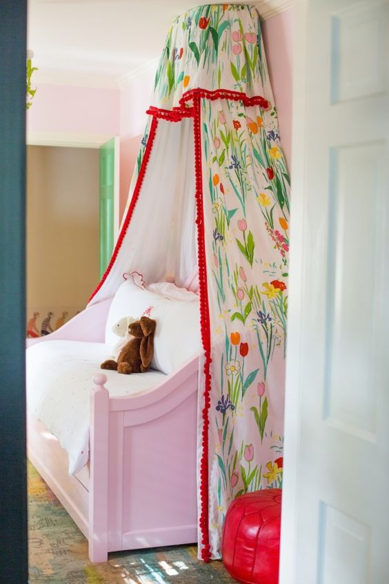 """McCarthy's little girl's bed canopy is not the only Marrot print in the space. Nearby Marrot's """"Feathers"""" print (below) hangs above the dresser. [Source:  Peppermint Bliss ]"""