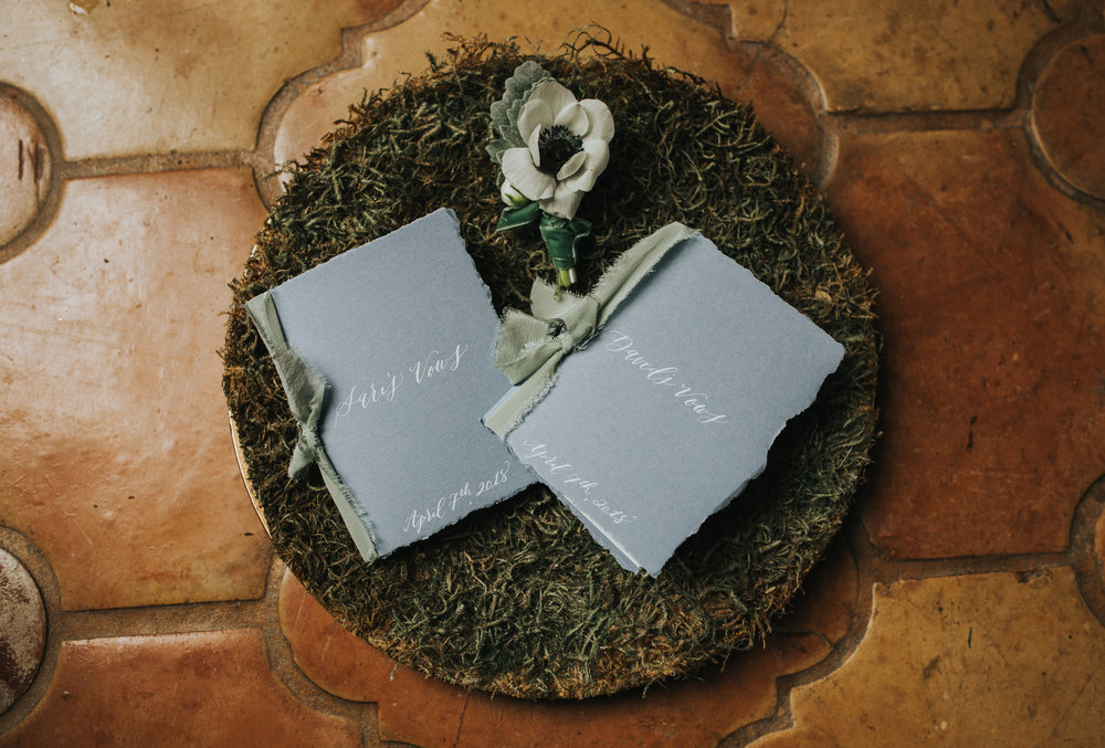 Handmade vow books by  Kelsey Carpenter  with deckled paper, silk ribbon and hand calligraphy.