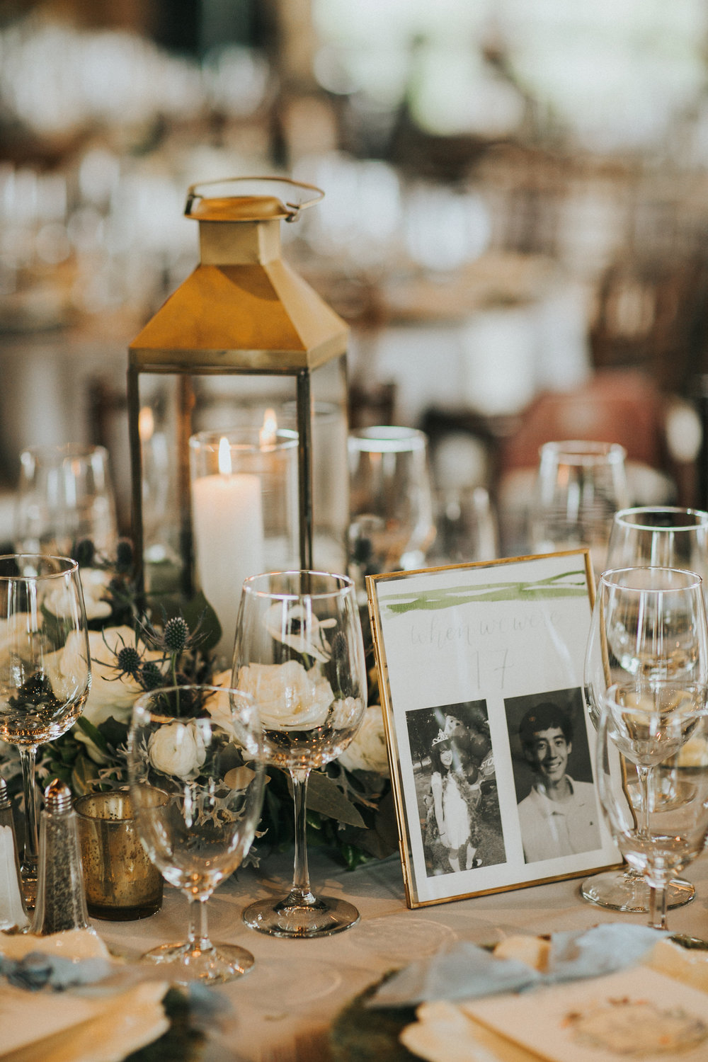 Every other table had a lantern with a floral wreath to bring more candlelit ambiance into the space. Table numbers made by  Grace Art Market  showcased photos of us from ages 1 to 20.