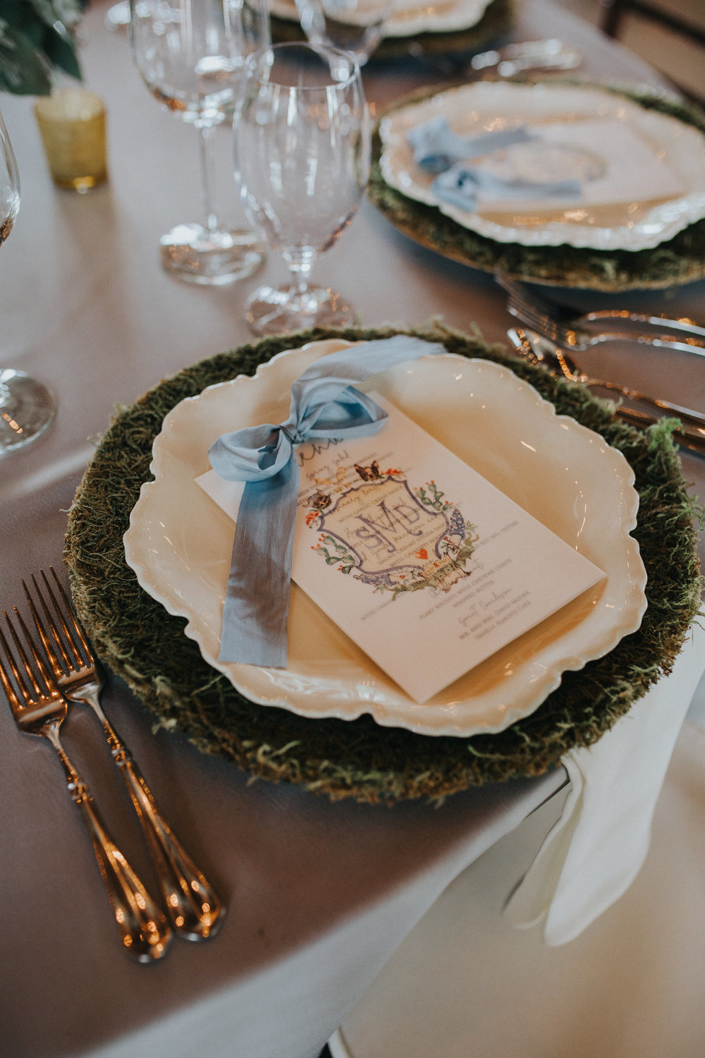 The custom menus featured the crest printed on a vellum overlay, tied together with a silk ribbon.