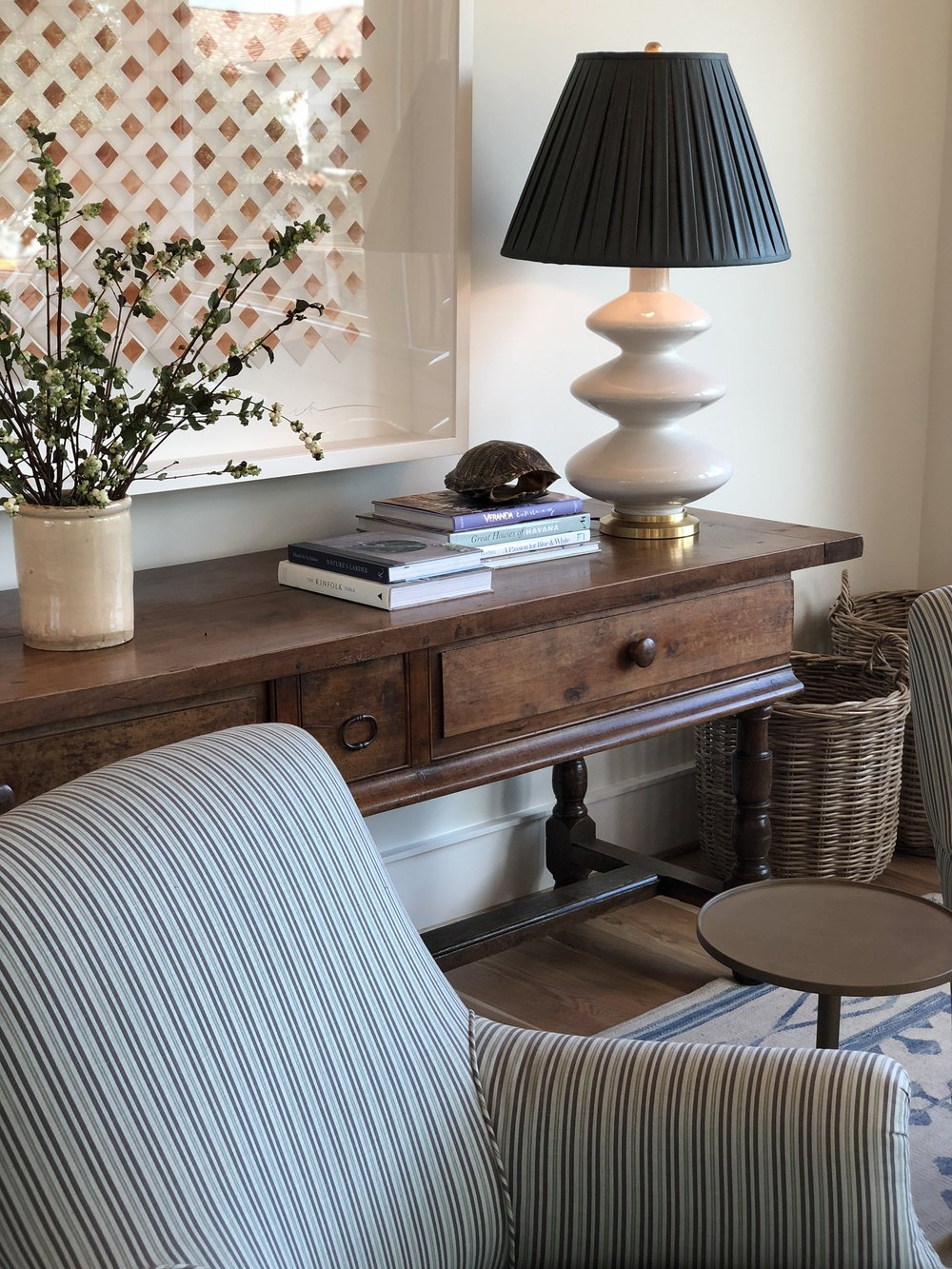 Meg's upstairs family room — art by Dimmitt Art, console from Joyce Horn Antiques.