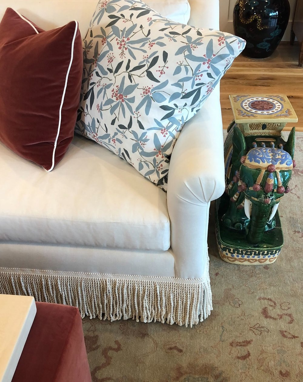 In the main living room, Lindsey added a formal touch with bullion fringe around the sofa.