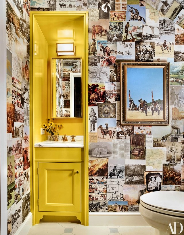 Pages from vintage western magazines and books adorn the walls of this powder bathroom.  / Source:    AD    / Photo by Trevor Tondro Photography Inc.