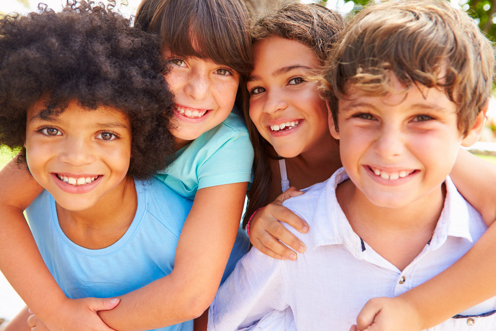 stock-photo-group-of-children-giving-each-other-piggyback-rides-236885392.jpg