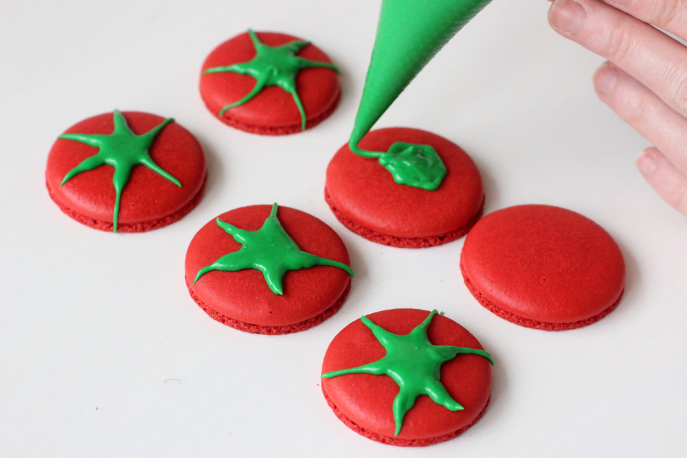 Step 4: Make royal icing and pipe leaves on tomatoes.