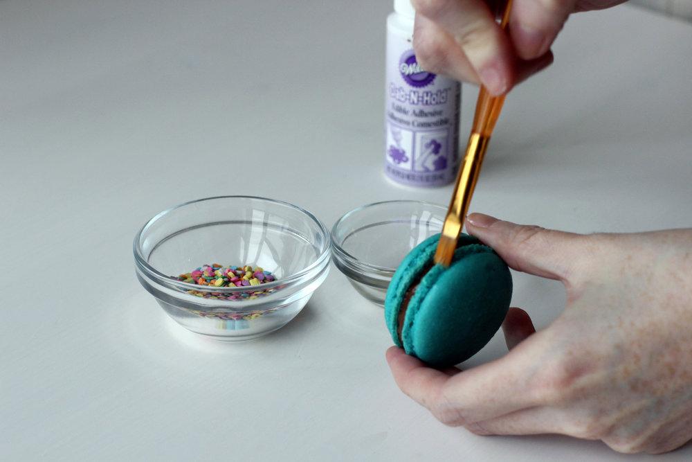Step 2: Glue sprinkles onto side of macaron.