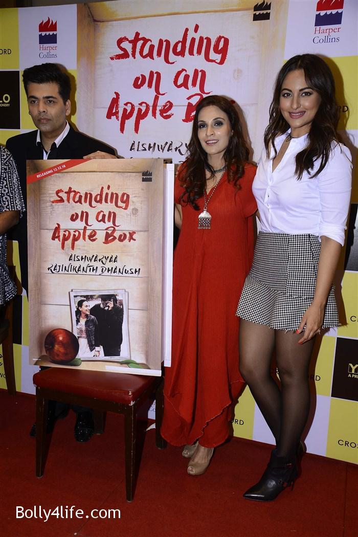 aishwarya_rajinikanth_dhanush_standing_on_an_apple_box_book_launch_stills_1a0f059.jpg