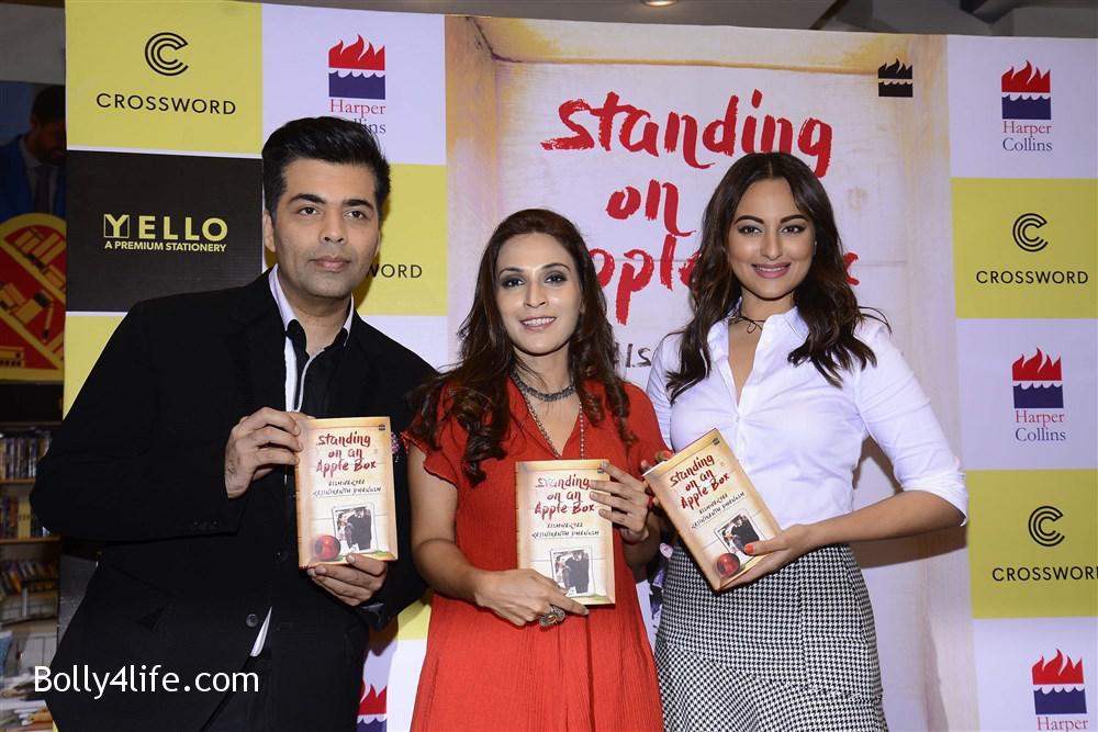 aishwarya_rajinikanth_dhanush_standing_on_an_apple_box_book_launch_stills_8a2a7d9.jpg