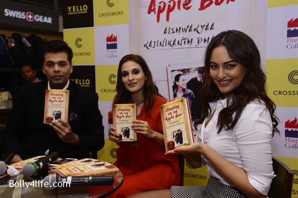 aishwarya_rajinikanth_dhanush_standing_on_an_apple_box_book_launch_stills_8f74808.jpg
