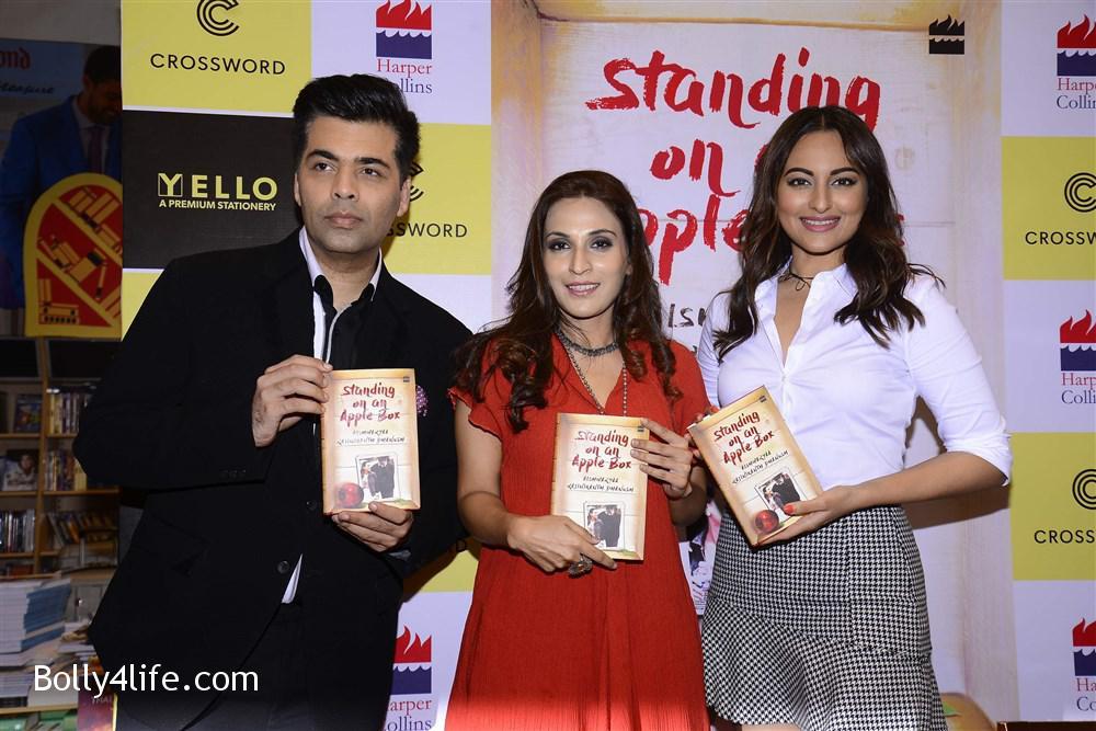 aishwarya_rajinikanth_dhanush_standing_on_an_apple_box_book_launch_stills_932df16.jpg