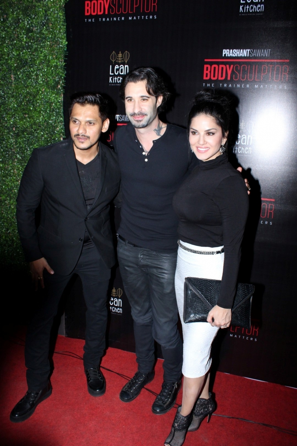Mumbai: Actress Sunny Leone with her husband Daniel Weber and Prashant Sawant, owner, Body Sculptor Gym during the launch party of Body Sculptor Gym in Mumbai on Jan 28, 2017. (Photo: IANS)