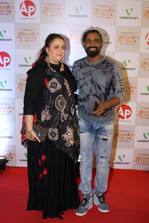 Mumbai: Choreographer Remo D'Souza along with his wife Lizelle D'Souza during the screening of film Kung Fu Yoga in Mumbai on Feb 2, 2017. (Photo: IANS)