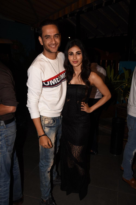 Mumbai: Producer Vikas Gupta and actress Mouni Roy during a programme in Mumbai on Aug 23, 2018. (Photo: IANS)