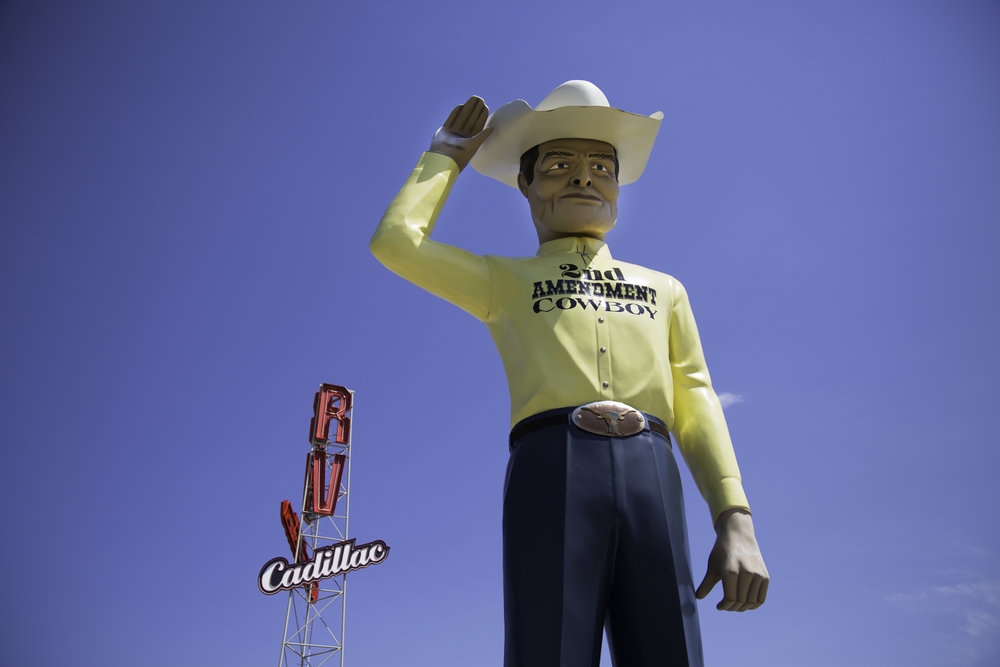 "Meet the 2nd Amendment Cowboy! He stands over two stories tall at the Cadillac RV Park just down the road from the Cadillac Ranch. Apparently, the cowboy originally advertised Amarillo Barbecue Steakhouse but was auctioned in 2014 to this RV Park.  A plaque stands in front of the cowboy quoting George Washington, ""A free people ought not only be armed and disciplined, but they should have sufficient arms and ammunition to maintain a status of independence from any who might attempt to abuse them, which would include their own government."""