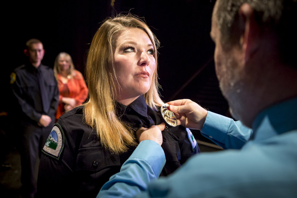 Susan (Suzi) Newman receives her badge during the pinning ceremony at the Community and Technical College Police Academy graduation on Friday, October 12th, 2018.