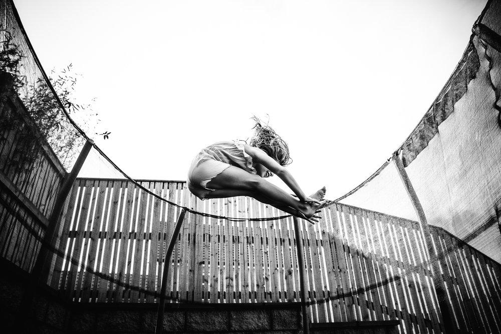 Aberdeen Family Photographer girl bouncing on trampoline