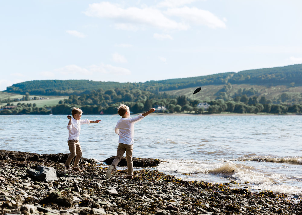 Aberdeen Family Photographer boys throwing stones into sea
