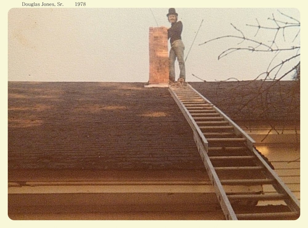 Doug Sr. sweeping a chimney in a traditional top hat back in 1978