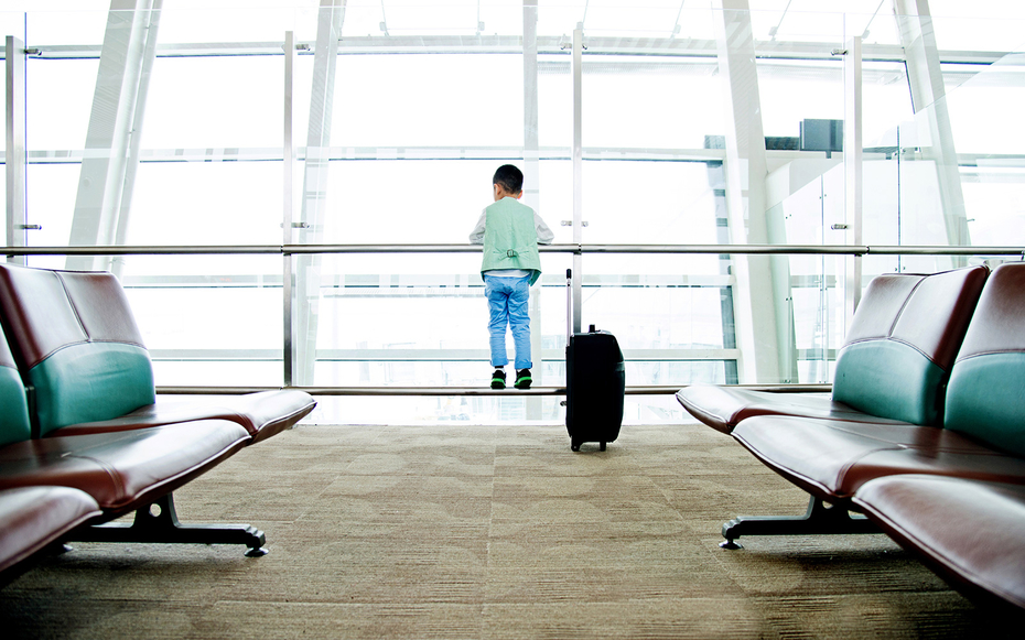 Boy with suitcase in airport