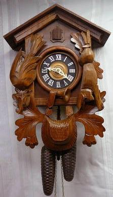 Antique mantel cuckoo clocks