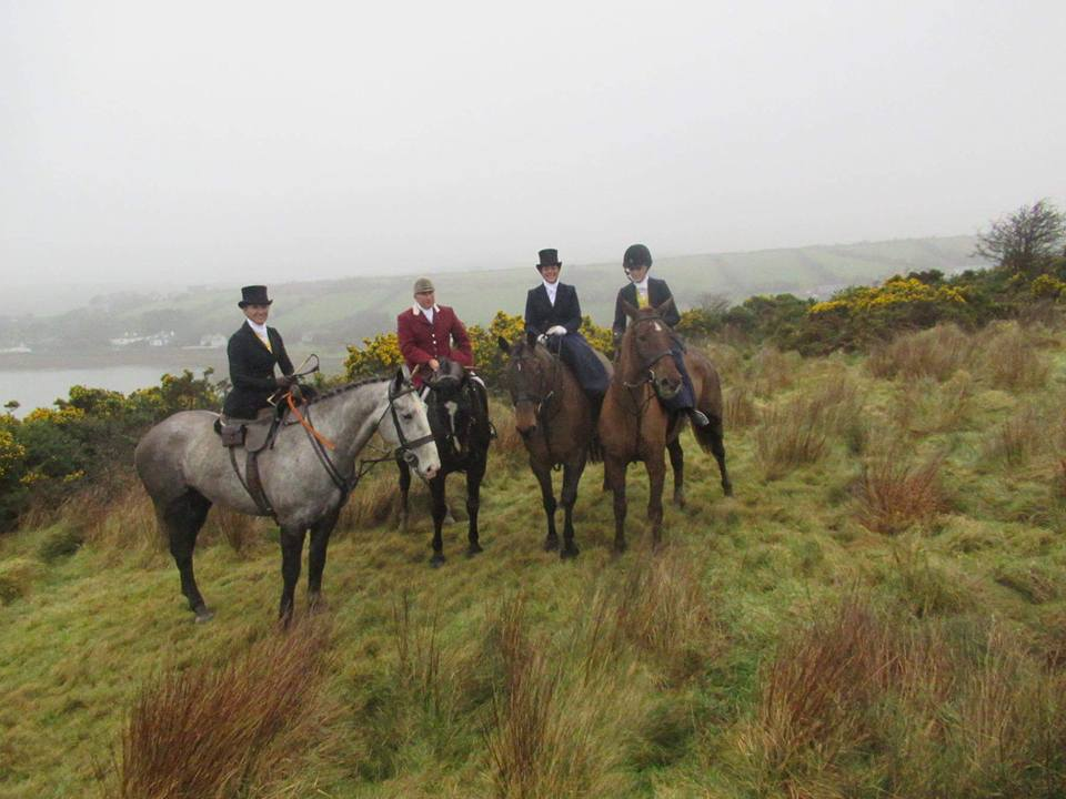 Overlooking the water: Maureen on Sportsman; the huntsman of the North Galway Hunt; Devon on Clover; and Bernadette on Chance