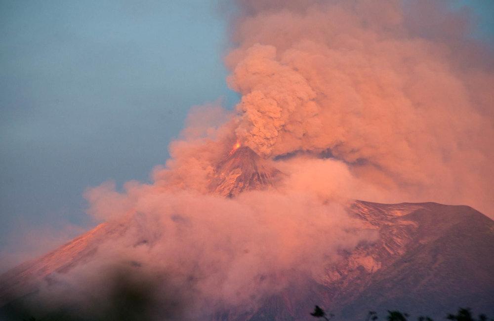 Volcan de Fuego erupting at dusk