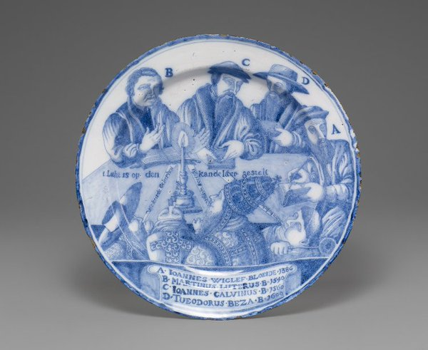 Delftware dish depicting the Protestant reformers Wyclif, Luther, Calvin and Beza, seated around the candle of the Gospel, 1692. British Museum, item no. 1891,0224.3; image no. AN1305850. © The Trustees