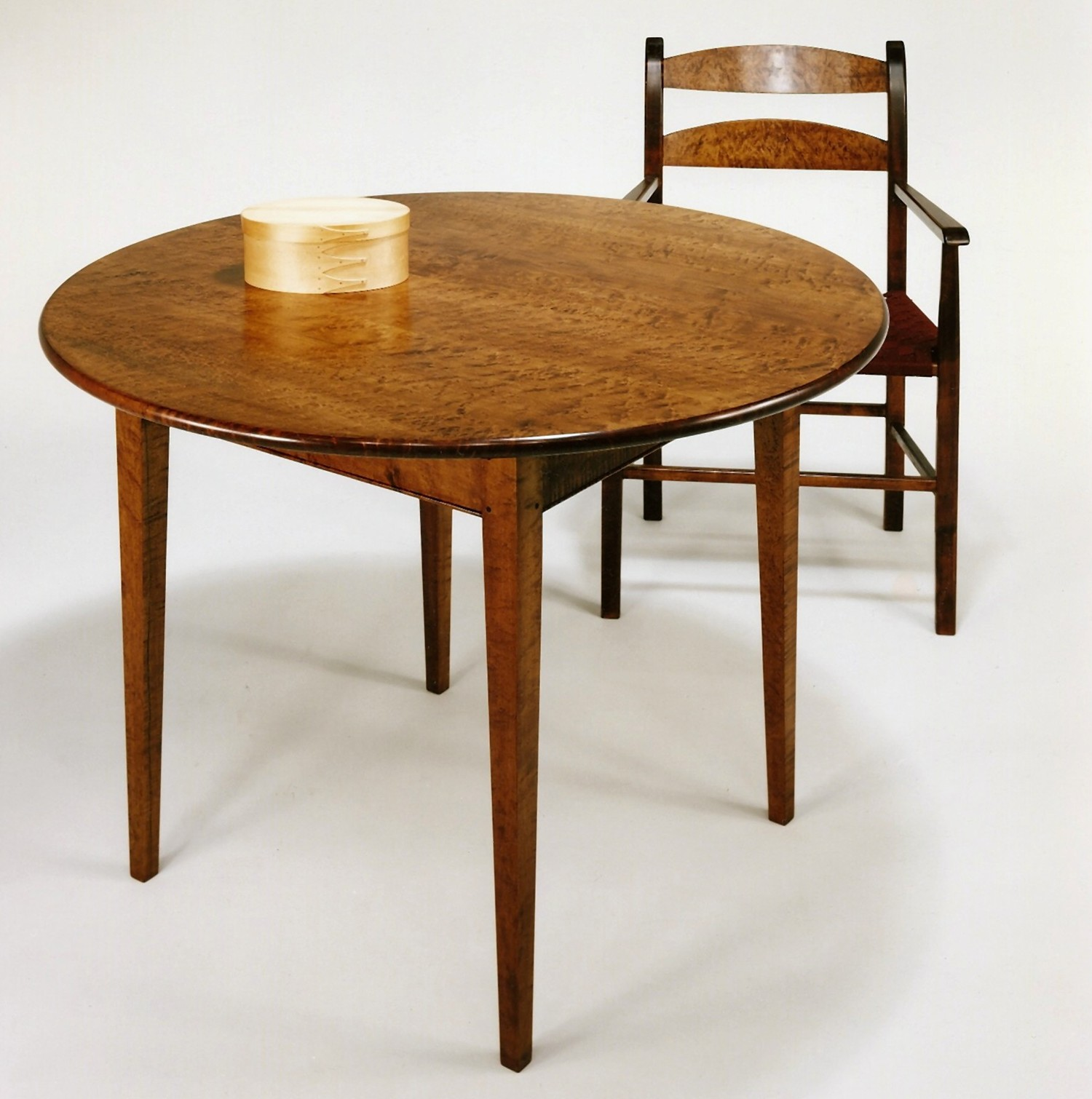 Round Dining Table With Thumb Back Arm Chair In Birds Eye Maple Amber 2