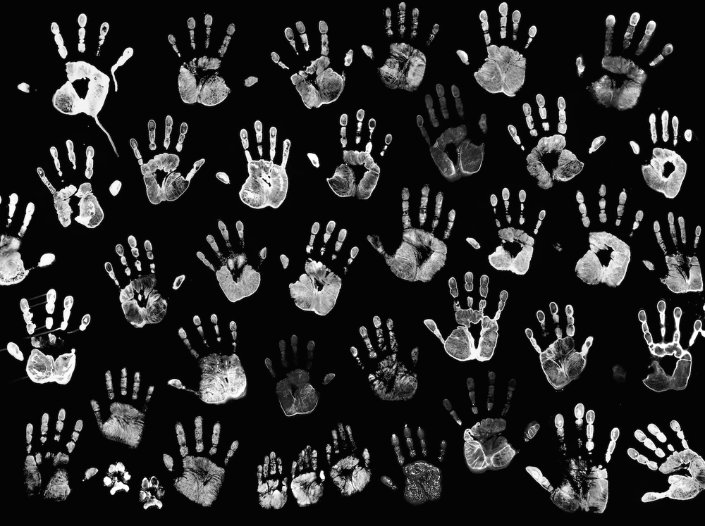 Connected  , a collage of handprints involving 30 veteran participants, their families and/or volunteers.