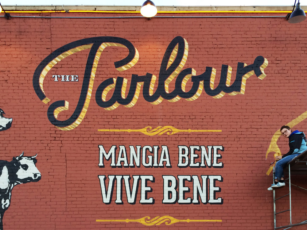 "Design and Painting:  ""The Parlour"" script by   Konanz & Co.    Design and Painting:  ""Mangia Bene..."" text and border elements by   Adrian Louden"