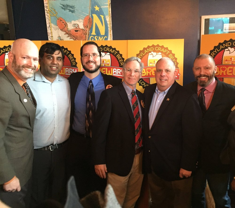 (L to R) Kelby Brick, Director of the Governor's Office of the Deaf & Hard of Hearing, Amit Rupani & Jason Bailey of SeaWolf Brewery, Mark Burke of Streetcar 82 with Governor Larry Hogan and Sam Costner of Streetcar 82.