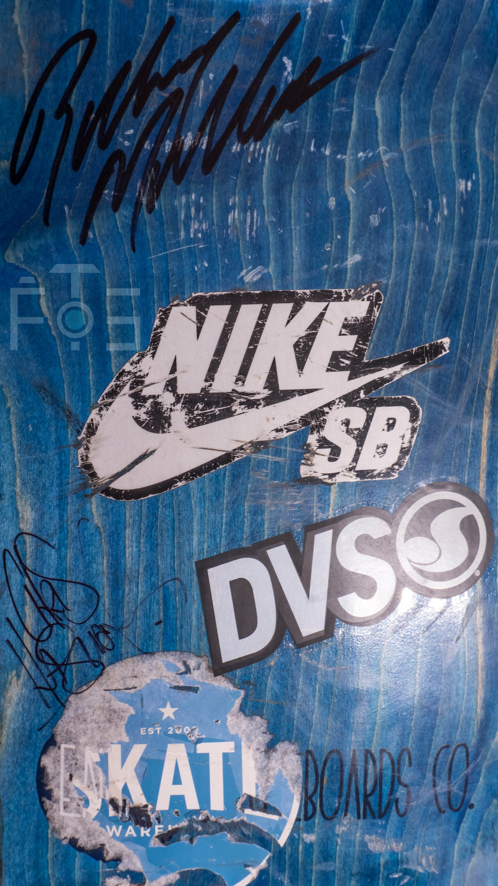 Rodney Mullen's and Chris Haslam's autographs on my board.  10 secs, f16.0, ISO 100.