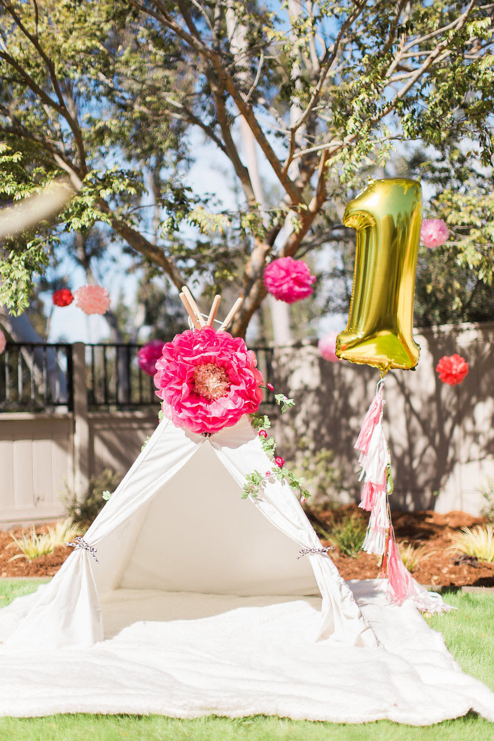 A bright and cheery teepee became the party photo booth and hangout spot.