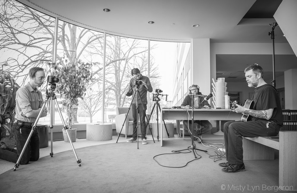 Part of the RSA crew documenting the performance of Lansing musician Martin Portier at the Archives of Michigan.