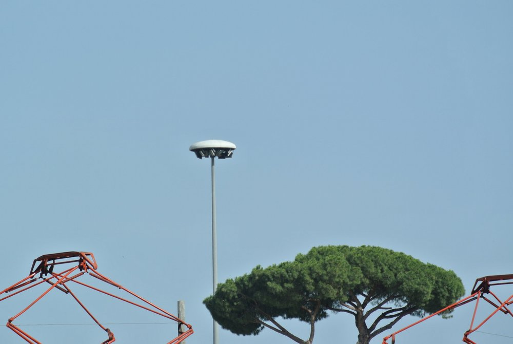 Satellite Station: a flying saucer flood lamp dots the space colony. Rome, Garbatella; June 2018.  ©Pamela Kerpius